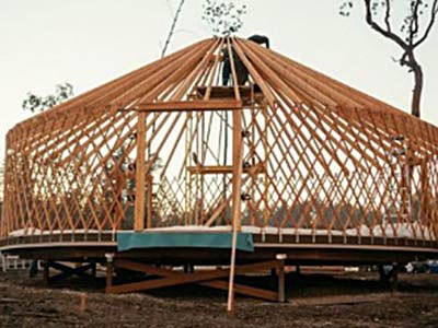 How a yurt,  is constructed in stages of framing, lattice, rafters and flooring, before the Rainier Outdoor Eagle yurt walls and roof are installed.