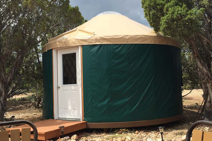 Notice the smart customer-added composite banding (Trex or Timbertech) around the base to keep insects and critters from coming up in between the fasteners. This material bends much easier on warm days – especially on a tight 16' diameter yurt.