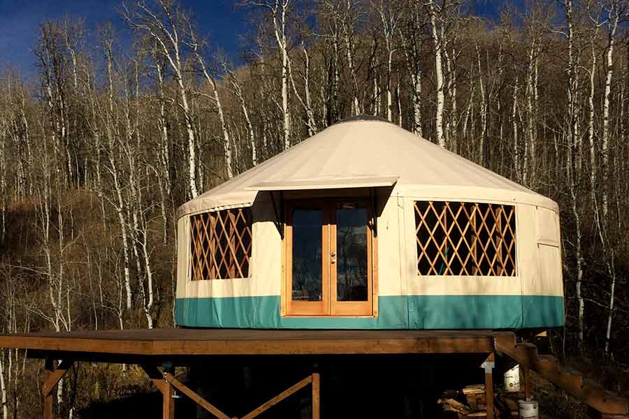 """In Scott's own words: in his words,"""" I understand that you are looking at building a yurt. Our family owns some recreation property in Summit County. My cousin built a yurt eleven years ago. We built our yurt this past summer. It was one of the best things we have done as a family. i hope you are able to realize your dream. We have all the conveniences in our yurt,, running water, electricity, wood stove, kitchen, and sleeping quarters. We built a bathroom in an adjoining building.The Rainer people, especially Dana Hendel, were great to work with."""