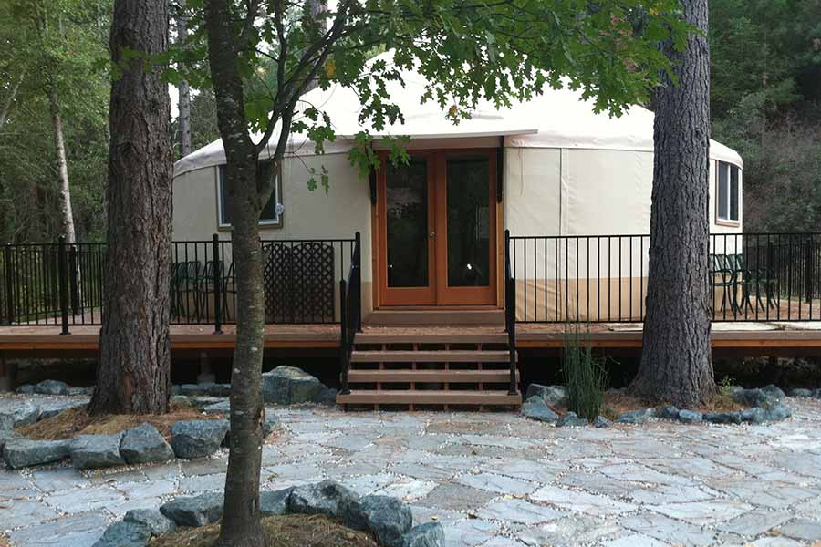 This gorgeous Eco Retreat Center sits among graceful pine trees in a setting that couldn't be more natural. The inside was left open to accommodate many guests at once. Installed by one of the Rainier-Recommended installers – also from Grass Velley.