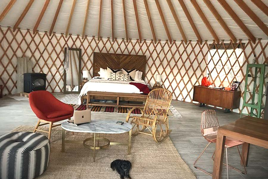 What is Open Living Style Glamping? It is of style Glamping where a yurt interior design and floor plan have no walls or partitions. It is one wide open living area, everybody is in the party!