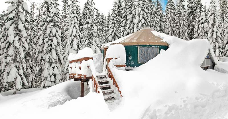 The Mount Tahoma Trails Yurt is blanketed in deep snow